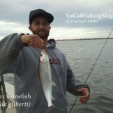 Angler holding a bonefish caught in San Diego Bay