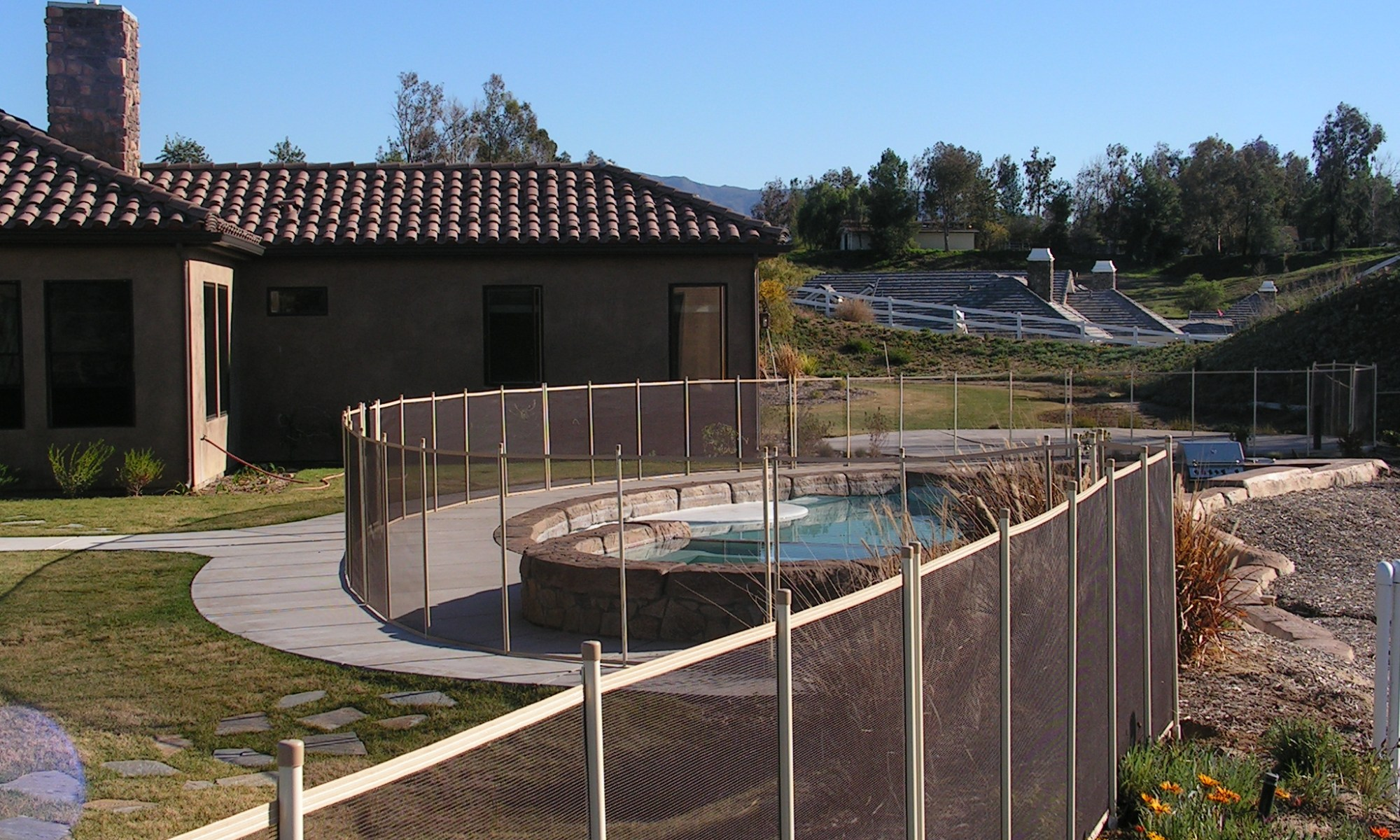 beige pool fencing