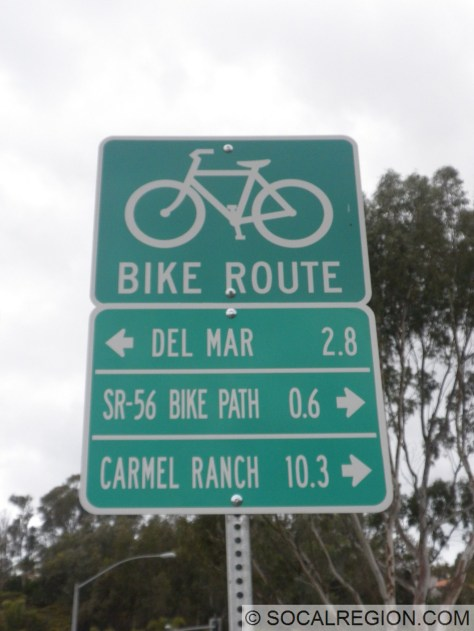 NB Sorrento Valley Rd at Carmel Valley Rd. Newer sign.