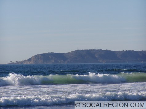 Point Loma from the Silver Strand. The Old Lighthouse is at center on the top of the ridge. The New Lighthouse is at the far left.