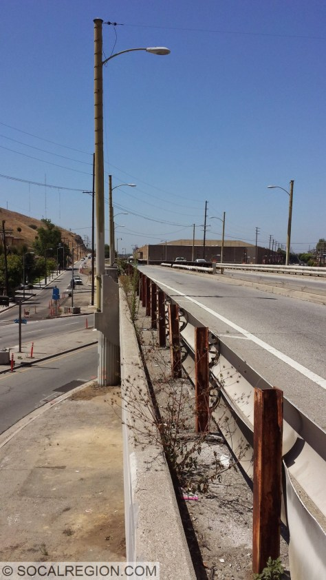 Former catenary poles and rail used as a light pole and barrier.