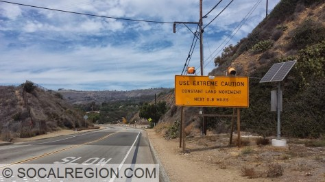 Warning sign on Palos Verdes Drive South approaching the landslide area.