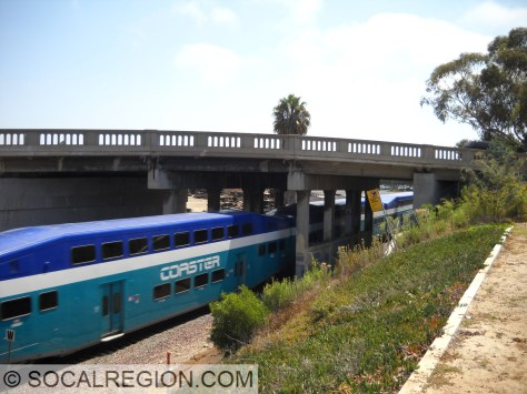 Northbound Coaster train passing underneath 101 in Carlsbad.