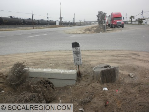 Culvert and station post at a former expressway crossover