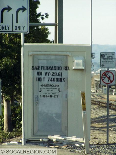 Railroad crossing box with San Fernando Road.