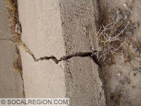 Fractured and slightly offset culvert at the San Andreas Fault scarp at Ave S.