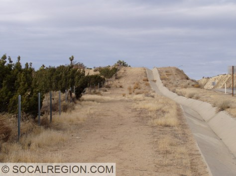 Fault scarp is visible as the abrupt rise in the background. This is along the 1857 rupture at the State 14 Freeway.