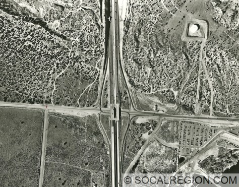 1999 aerial photo showing the San Andreas Fault crossing State 14 at Ave S in Palmdale. The scarp passes through the upper ramps to State 14. at an angle