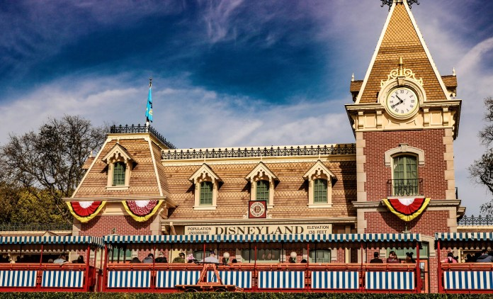 Mickey and Minnie flags can be found throughout the park, including City Hall, Main Street Station, and across the entire street side of Main Street!