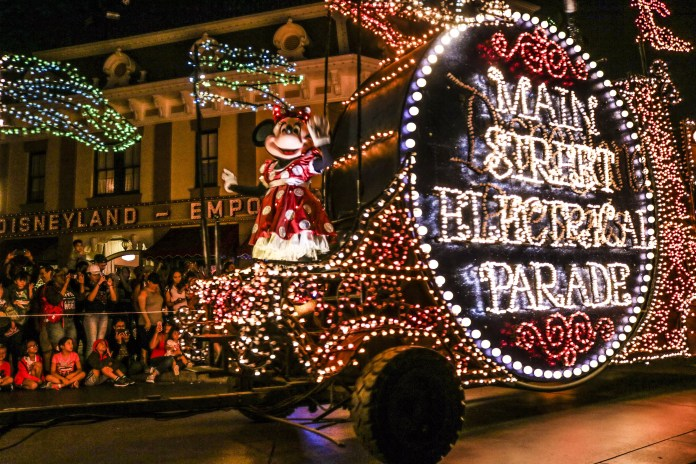 Minnie greets guests during the Main Street Electrical Parade at Disneyland.