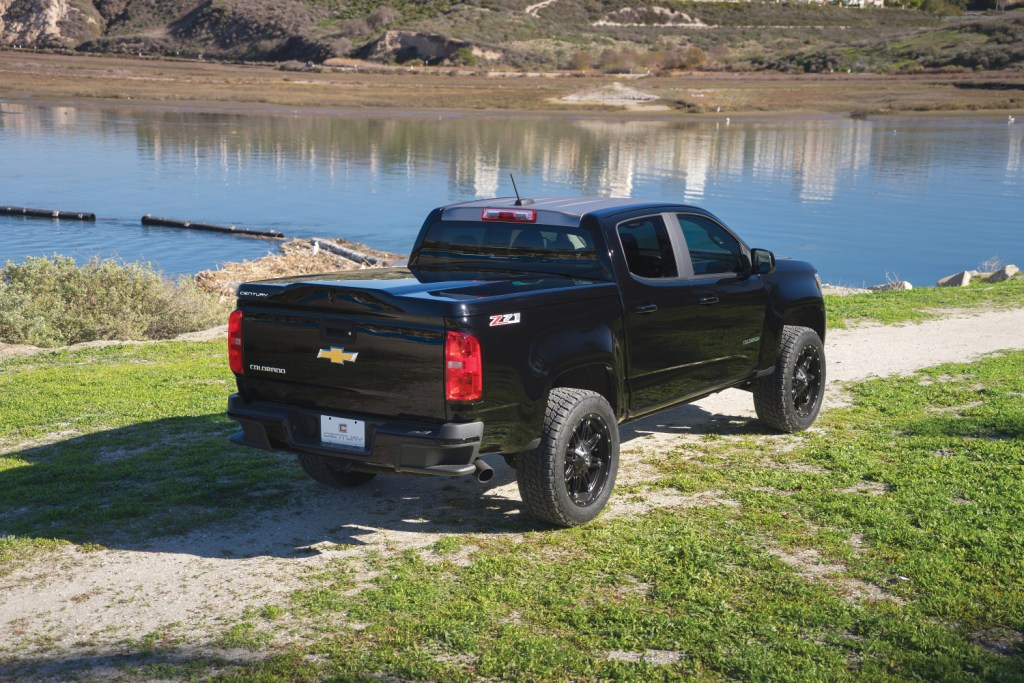 The Century Silhouette shown installed on a Chevrolet Colorado taken in front of a lake front.