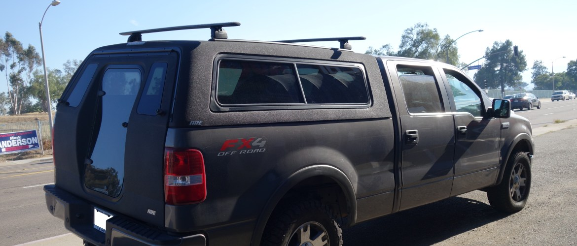 ARE OTR w/ rear door and Yakima roof rack for ease of access to rear of your vehicle.