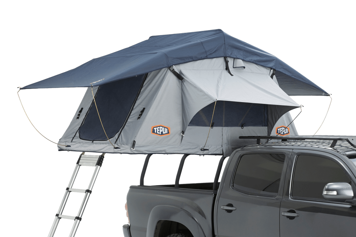 Tepui rooftop tent shown installed on a vehicle in haze grey.