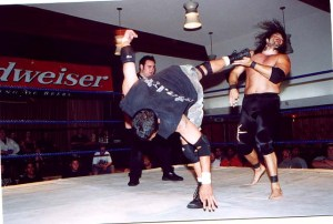 Primetime Peterson kicking Peter Maivia Jr. at an ACW event in Reseda