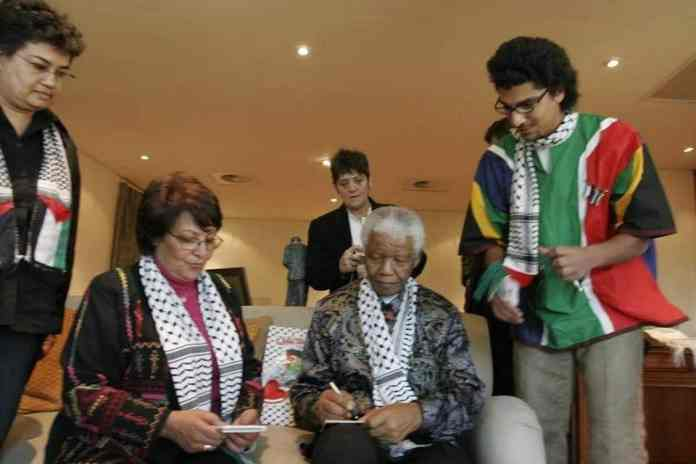 Two freedom fighters: Leila Khaled and Nelson Mandela. Photo by Sana Kassem