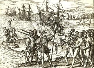 Columbus landing on Hispaniola, October 12, 1492; greeted by Arawak Indians. Litographi by Theodor de Bry (1528 – 27 March 1598) based on eyevitnesses. Public Domain Source: https://sw.wikipedia.org/wiki/Picha:Columbus_landing_on_Hispaniola.JPG