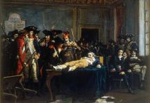 Lying on a table, wounded, in a room of the Convention, Robespierre is the object of the curiosity and quips of Thermidorians, painting by Lucien-Étienne Mélingue (Salon de 1877)(Musée de la Révolution française) Date: circa 1877. License: Creative Commons Attribution-Share Alike 2.0 fr.