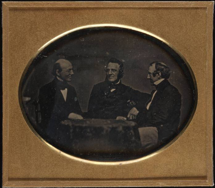 Garrison and fellow abolitionists George Thompson and Wendell Phillips, seated at table, daguerreotype, ca. 1850–1851. Author/Creator: Southworth and Hawes, Boston. Cite as: Yale Collection of American Literature, Beinecke Rare Book and Manuscript Library. (CC BY 2.0)