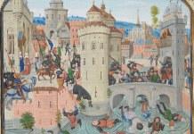 Gaston Phébus et Jean de Grailli chargent les Jacques et les parisiens qui tentent de prendre la forteresse du marché de Meaux où est retranchée la famille du Dauphin. (9 Juin 1358). XV eme siècle. Author: Jean Froissart (1337–1410). Public Domain.