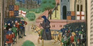 "An illustration of the priest John Ball (""Jehã Balle"") on a horse encouraging Wat Tyler's rebels (""Waultre le tieulier"") of 1381, from a ca. 1470 manuscript of Jean Froissart's Chronicles in the British Library. There are two flags of England (St. George's cross flags) and two banners of the Plantagenet royal coat of arms of England (quarterly France ancient and England), and an implausible number of unmounted soldiers wearing full plate armour among the rebels. Source: Detail of British Library manuscript ""Royal 18 E. I f.165v"" as scanned at http://molcat1.bl.uk/IllImages/Ekta/big/E025/E025825.jpg (see also here). Author: Unknown medieval artist illustrating Froissart's Chronicles. Public Domain"