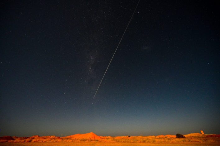 A capsule from Japan's Hayabusa-2 space probe streaks through the night sky