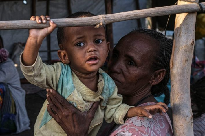 Refugees from the Tigray region of Ethiopia wait to be transferred to a camp