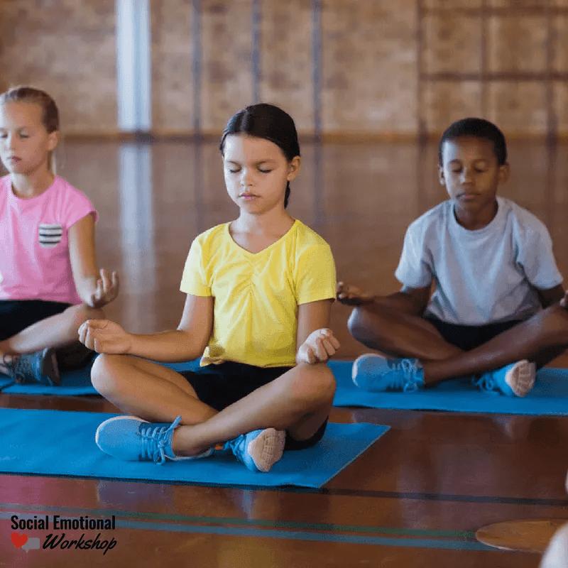 kids practicing yoga in school