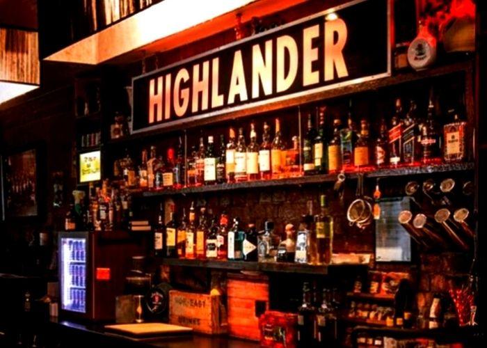 whiskey and scottish ale bottles on highlander shelf inside highlander bar in cbd