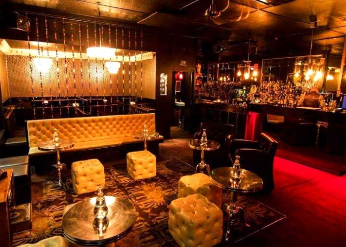 decoratively lit berlin bar on corrs lane with east/west themed bar with plush banquettes and bunker style decor