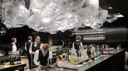 bar tenders and restaurant staff making drinks at the vue de monde kitchen