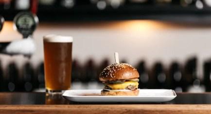 burger boys burger and full beer glass on bar