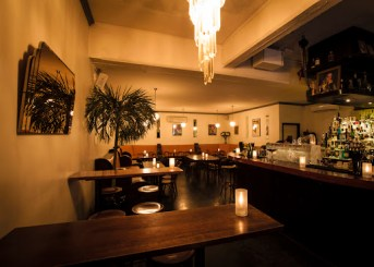 empty bar with candles and tables at lily blacks melbourne