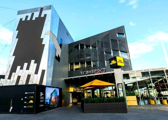 outside street view of renovated transport hotel public bar at federation square with blue sky's on summer day