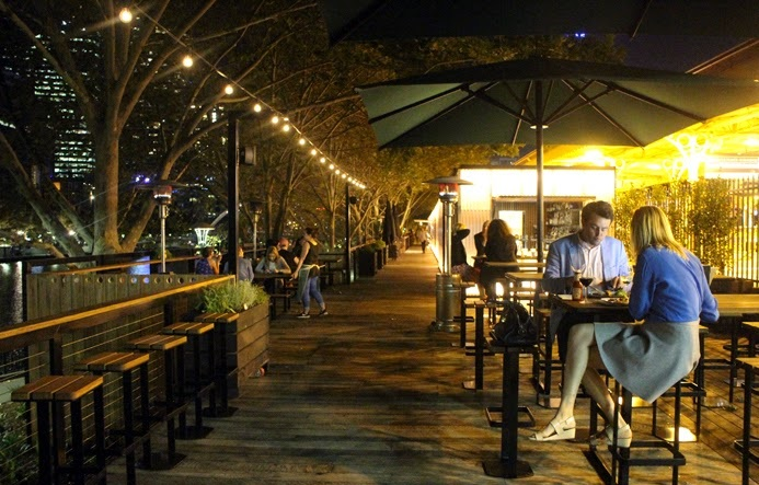 people seated at river side bar in melbourne cbd