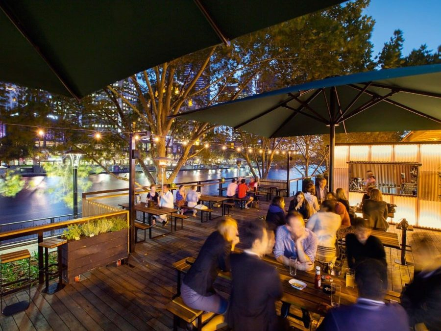 people dining in the evening at arbory bar and eatery outdoor restaurant