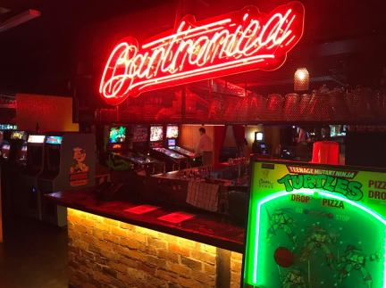 red neon bartronica bar with retro arcade games