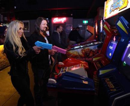 man and woman playing time crisis at melbourne arcade bar