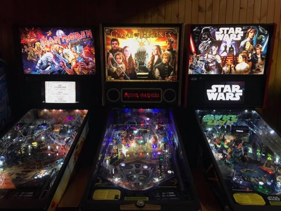 three arcade pinball machines; star wars, and game of thrones and iron maiden