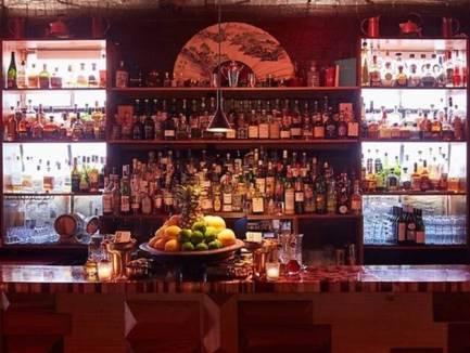 main cocktail bar with drinks at seamstress