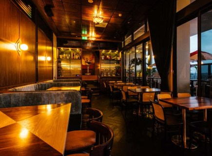 beautiful dining area with polished wooden interior of nick and nora's Melbourne restaurant with empty tables