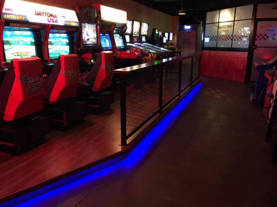 arcade machines in bartronica with blue neon strip light