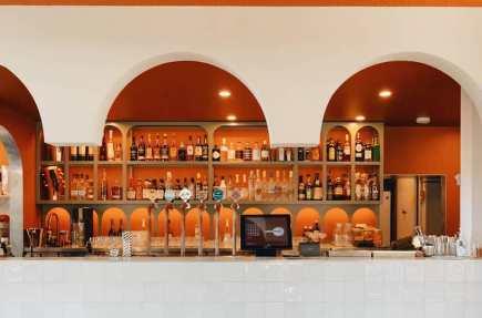 decorative orange bar with wine and spirts on shelves