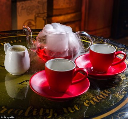 magical drinks red tea pot and tea cups with dry ice smoke
