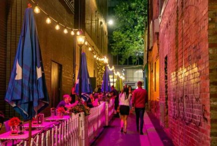 melbourne laneway restaurant at storyville diners eating and white fence at 185 lonsdale street