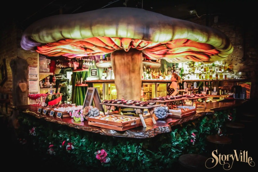 storyville's middle floor mushroom toadstool bar with cocktails and bar tender making drinks