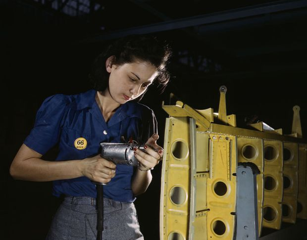 767px-Operating_a_hand_drill_this_woman_worker_is_shown_working_on_the_horizontal_stabilizer