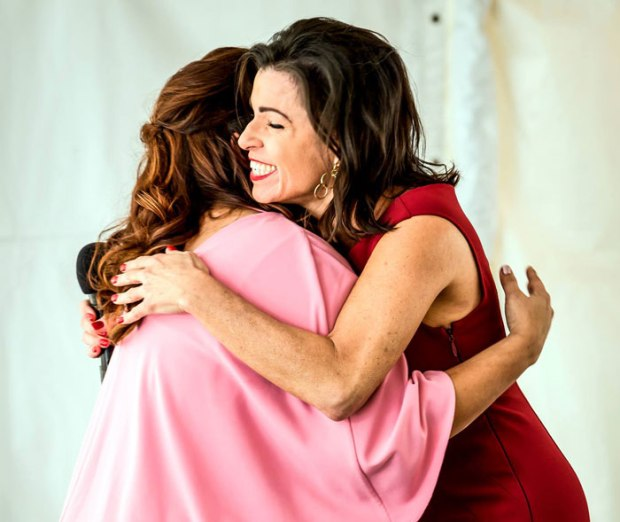 Elizabeth-Melendez-Fisher,-PresidentCEO-of-Selah-Freedom,-embraces-a-survivor-graduate-after-she-bravely-shares-her-story.-(1)