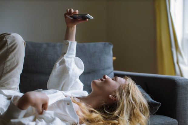 woman-in-white-dress-shirt-holding-a-smartphone-4236827