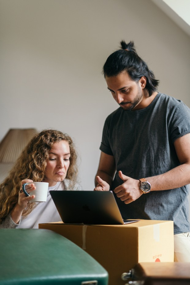 young-couple-buying-things-for-new-house-online-using-laptop-4247721