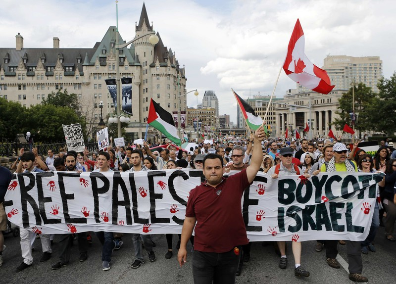 Pro-Palestinian protesters take part in a demonstration against Israel's military action in the Gaza Strip, in Ottawa